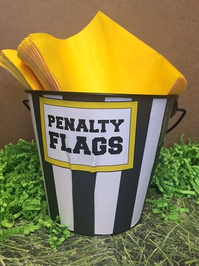 Napkins in a Penalty Flag Bucket