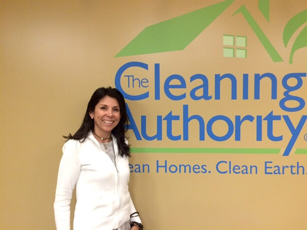Woman in Front of The Cleaning Authority Sign